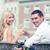 smiling couple drinking wine in cafe stock photo © dolgachov