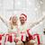boldog · pár · karácsony · ajándék · ül · kandalló - stock fotó © dolgachov