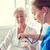 szívdobbanás · orvos · idős · női · beteg · nővér - stock fotó © dolgachov