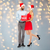 happy couple in santa hats with red sale sign stock photo © dolgachov