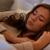 boldog · fiatal · nő · párna · ágy · otthon · alszik - stock fotó © dolgachov