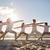 group of people making yoga exercises on beach stock photo © dolgachov