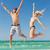 feliz · Pareja · saltar · playa · vacaciones · de · verano · hombre - foto stock © dolgachov