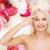 beautiful woman touching her forehead stock photo © dolgachov