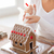 close up of woman making gingerbread house at home stock photo © dolgachov