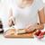 close up of woman with blender chopping banana stock photo © dolgachov