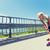 mulher · jovem · ferido · joelho · em · ao · ar · livre · fitness - foto stock © dolgachov