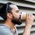 молодым · человеком · питьевой · кофе · одноразовый · Кубок · белый - Сток-фото © dolgachov