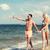 couple · plage · heureux · homme · pointant - photo stock © dolgachov