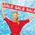 smiling woman in red dress with sale sign stock photo © dolgachov