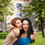 two smiling girls showing thumbs up stock photo © dolgachov