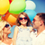 happy family with colorful balloons outdoors stock photo © dolgachov