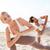 close up of couple making yoga exercises outdoors stock photo © dolgachov