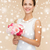 smiling woman in white dress with bunch of flowers stock photo © dolgachov