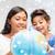 meisje · sneeuw · wereldbol · meisje · binnenkant - stockfoto © dolgachov
