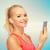 mosolyog · sportos · nő · okostelefon · fülhallgató · sport - stock fotó © dolgachov