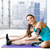 smiling woman stretching leg on mat over gym stock photo © dolgachov