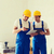 builders with tablet pc and equipment indoors stock photo © dolgachov