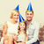 happy family in hats celebrating stock photo © dolgachov