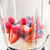close up of blender shaker with fruits and berries stock photo © dolgachov