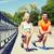 smiling couple stretching leg outdoors stock photo © dolgachov