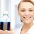 lab worker holding up bottle with blue liquid stock photo © dolgachov