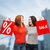 two smiling teenage girl with shopping bags stock photo © dolgachov