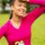smiling teenage girl showing bottle stock photo © dolgachov
