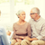 senior couple hugging at home stock photo © dolgachov
