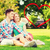 smiling couple sitting on grass in summer park stock photo © dolgachov
