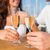 smiling couple clinking champagne glasses at cafe stock photo © dolgachov