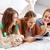 friends or teen girls reading magazine at home stock photo © dolgachov