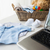 close up of baby clothes toys and laptop at home stock photo © dolgachov