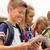 grupo · feliz · escuela · primaria · estudiantes · aire · libre · primario - foto stock © dolgachov