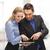 üzletasszony · üzletember · táblagép · üzletemberek · technológia · vállalati - stock fotó © dolgachov