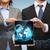 üzletember · üzletasszony · bolygó · hologram · üzlet · jövő - stock fotó © dolgachov