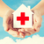 hands holding paper house with red cross stock photo © dolgachov