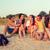 boldog · fiatalok · ül · tábortűz · együtt · csoport - stock fotó © dolgachov