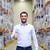 happy man at warehouse showing thumbs up gesture stock photo © dolgachov