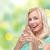 feliz · mulher · jovem · indicação · dedo · gesto · pessoas - foto stock © dolgachov
