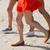 close up of women legs running on beach stock photo © dolgachov