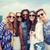 happy hippie friends with selfie stick over city stock photo © dolgachov