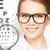 woman with magnifier and eye chart stock photo © dolgachov