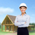 femme · d'affaires · blanche · casque · bras · bâtiment · développement - photo stock © dolgachov