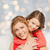 happy mother with daughter hugging and talking stock photo © dolgachov