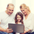 parents and little girl with laptop at home stock photo © dolgachov