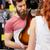asszisztens · mutat · vásárló · gitár · zene · bolt - stock fotó © dolgachov