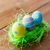 close up of colored easter eggs and grass stock photo © dolgachov
