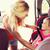 happy mother fastening child with car seat belt stock photo © dolgachov