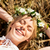 happy woman in wreath of flowers lying on straw stock photo © dolgachov